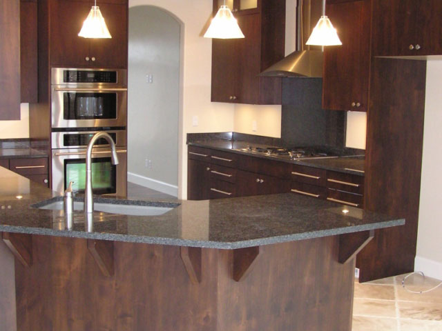 sleek dark kitchen cabinets