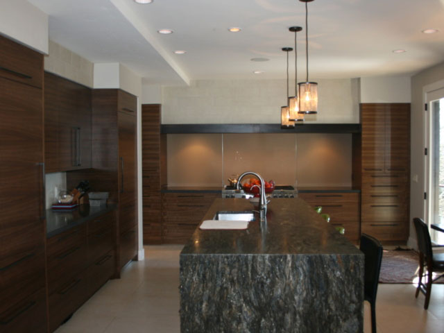kitchen with waterfall countertop island