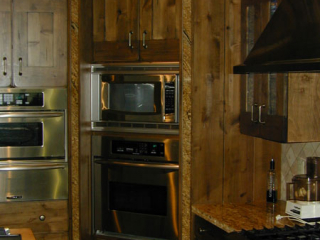 custom corner cabinetry with built in stove